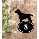 Cocker Spaniel Iron House Number Sign in Situ on a Rustic Wall