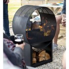 Contemporary Circular Steel Wood Burner in Use Outside