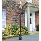 Copper Victorian lamp post outside house
