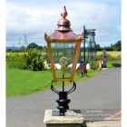 Copper Victorian Pillar Light and Lantern Set on a Brick Pillar