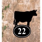 Cow Iron House Number Sign in Situ on a Rustic Wall