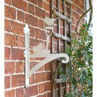Cream Robin on Garden Shovel Hanging Basket Bracket in Situ on a Brick Wall