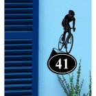 Cyclist Iron House Number Sign on a Blue Wall