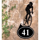 Cyclist Iron House Number Sign in Situ on a Rustic Wall
