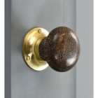 Leopard Print door knob with brass back plate on grey door