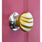 Stone Effect door knob with Bright chrome back plate on pink door