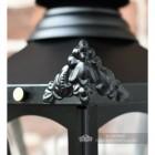 Detailed image of Victorian corner finial on hexagonal wall lantern