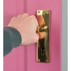 Brass Victorian Curved Lever Handle on Pink Door in Use