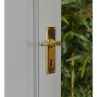 Brass Victorian Curved Handle Deluxe on an Open Grey Door