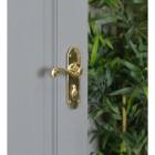 Polished Brass 6 Inch Lever Lock Handle on Grey Door