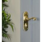 Polished Brass 6 Inch Lever Lock Handles on Grey Door in Situ