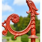 Distressed Red Ornate Scroll Work On Lamp Post