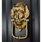 """""""Downing street lion"""" Door Knocker on a Black Door"""