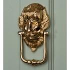 """""""Downing street lion"""" Door Knocker on a Green Door"""