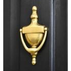 Gold Anodised Urn Door Knocker on a Black Door