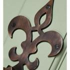Close up of French Fleur de lys symbol door knocker