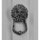 Green man door knocker on front door