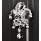 Bright Chrome Jester door knocker on black door