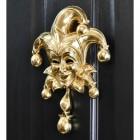 Polished Brass Jester Door Knocker on Black door