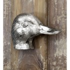 Bright Chrome Duck Head Door Knocker on Brown door