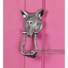Bright Chrome Fox Head Door Knocker on a Pink Door
