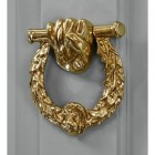 Polished Brass Fist & Laurel door knocker on grey door