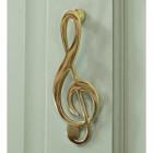Polished Brass Music Note door knocker on pale green door