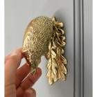 Solid Brass Door Knocker on grey door, in use with hand