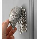 Bright Chrome Hedgehog door knocker on grey door scale image