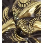 Detailed image of dragon scales on solid brass door knocker