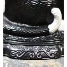 Close up of hand door stop cast detail