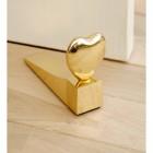polished brass door stop