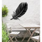 Feather Wall Art in Use in the Garden Above a Wooden Table and Chair Set