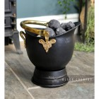 """Countess"" Coal Bucket Holding coal"