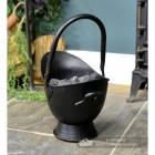 Small Black Coal Bucket Holding Coal