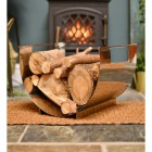 Stainless Steel Curved log holder infront of fire