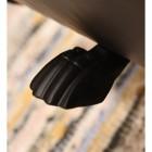 close up of foot under log holder