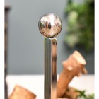 Detailed imago of ball finial on simplistic fire grate fire dog