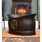 Celtic coal or log bucket infront of fire