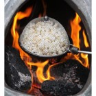 Fire Pit Popcorn Pan Being Used to Cook Popcorn