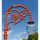 Frosted Glass Globe Luminaire On ornate lamp post bracket