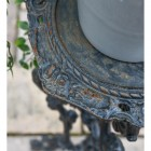 Close up of Aged Black Cast Iron Side Table Top