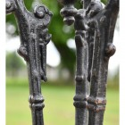 Close up of Aged Black Cast Iron Table Legs
