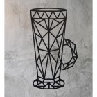 Geometric Steel Latte Glass Wall Art on a Rustic Wall