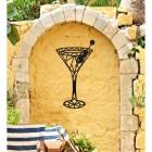 Geometric Steel Martini Glass Wall Art on a Yellow Garden Wall