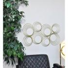 Gold Spiral Wall Artin a Modern Sitting Room