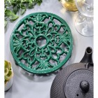 Heavy Duty Cast Iron Round Trivet Being Used on a Dining Room Table