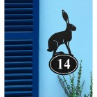 Hare Iron House Number Sign in Situ on a Blue Wall