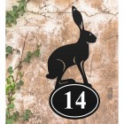 Hare Iron House Number Sign in Situ on a Rustic Wall