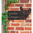 Hen & Chicks Iron House Name Sign in Use on a Brick Wall